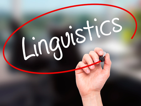 Man Hand writing Linguistics  with black marker on visual screen. Isolated on background. Business,  technology, internet concept. Stock Photo Reklamní fotografie