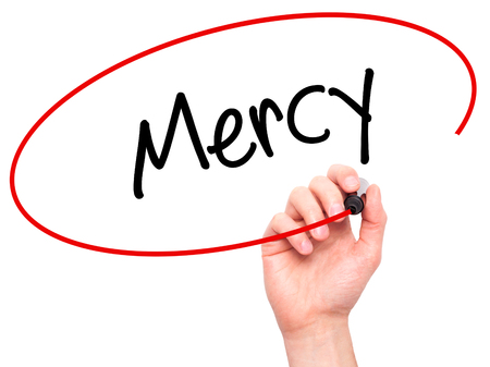 personal god: Man Hand writing Mercy with black marker on visual screen. Isolated on white. Business, technology, internet concept. Stock Photo