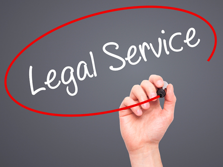 solicitor: Man Hand writing Legal Service with black marker on visual screen. Isolated on background. Business, technology, internet concept. Stock Photo