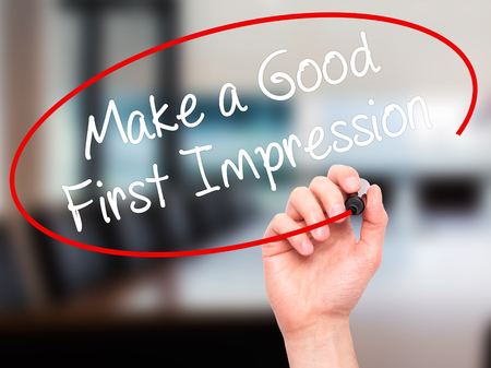 pioneering: Man Hand writing Make a Good First Impression with black marker on visual screen. Isolated on background. Business, technology, internet concept. Stock Photo Stock Photo