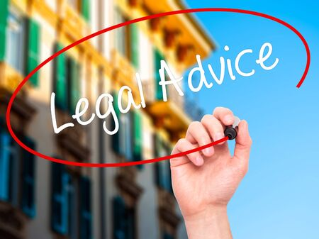 governing: Man Hand writing Legal Advice with black marker on visual screen. Isolated on city. Business, technology, internet concept. Stock Photo Stock Photo