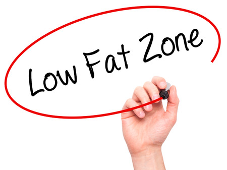 low fat: Man Hand writing Low Fat Zone with black marker on visual screen. Isolated on white. Business, technology, internet concept. Stock Photo
