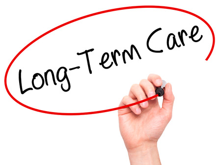 ltc: Man Hand writing Long-Term Care with black marker on visual screen. Isolated on white. Business, technology, internet concept. Stock Photo