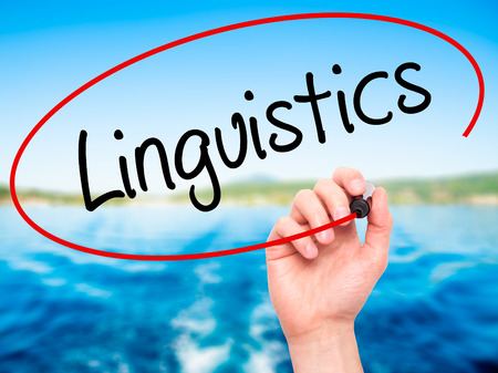 linguistics: Man Hand writing Linguistics  with black marker on visual screen. Isolated on background. Business,  technology, internet concept. Stock Photo Stock Photo