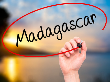 fort dauphin: Man Hand writing Madagascar with black marker on visual screen. Isolated on nature. Business, technology, internet concept. Stock Photo