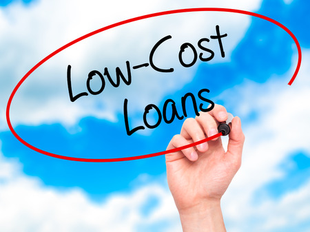 interst: Man Hand writing Low-Cost Loans with black marker on visual screen. Isolated on background. Business, technology, internet concept. Stock Photo