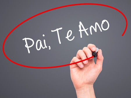 te: Man Hand writing Pai, Te Amo (In portuguese - Love You, Dad) with black marker on visual screen. Isolated on grey. Business, technology, internet concept.