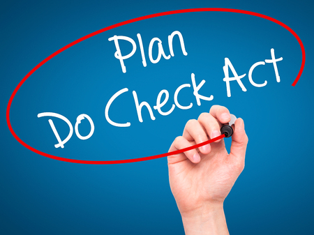plan do check act: Man Hand writing Plan Do Check Act  with black marker on visual screen. Isolated on blue. Business, technology, internet concept. Stock Photo