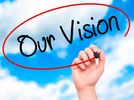 our vision: Man Hand writing Our Vision with black marker on visual screen. Isolated on sky. Business, technology, internet concept. Stock Photo
