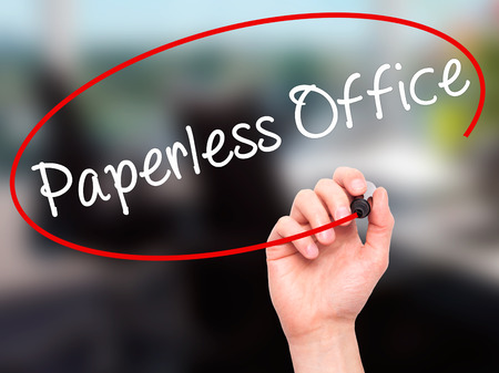 paperless: Man Hand writing Paperless Office  with black marker on visual screen. Isolated on office. Business, technology, internet concept. Stock Photo Stock Photo
