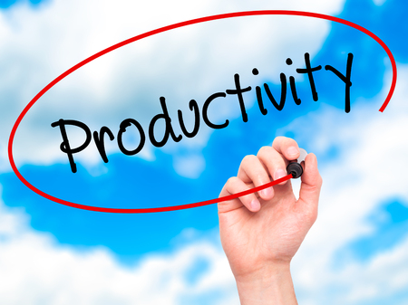 yielding: Man Hand writing  Productivity with black marker on visual screen. Isolated on sky. Business, technology, internet concept. Stock Photo