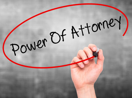 deeds: Man Hand writing Power Of Attorney with black marker on visual screen. Isolated on grey. Business, technology, internet concept. Stock Photo