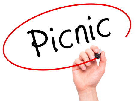 picknick: Man Hand writing Picnic with black marker on visual screen. Isolated on white. Business, technology, internet concept. Stock Photo
