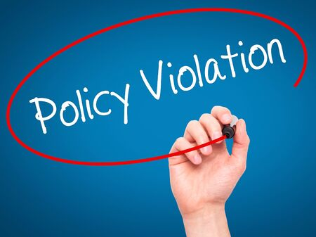 violation: Man Hand writing Policy Violation with black marker on visual screen. Isolated on blue. Business, technology, internet concept. Stock Photo