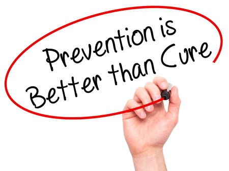 cure prevention: Man Hand writing Prevention is Better than Cure with black marker on visual screen. Isolated on white. Business, technology, internet concept. Stock Photo