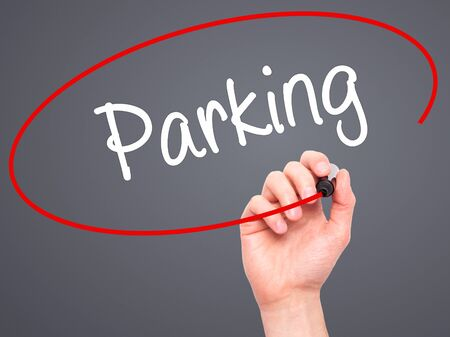 sunroof: Man Hand writing Parking with black marker on visual screen. Isolated on grey. Business, technology, internet concept. Stock Photo