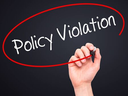 violaci�n: Man Hand writing Policy Violation with black marker on visual screen. Isolated on black. Business, technology, internet concept. Stock Photo