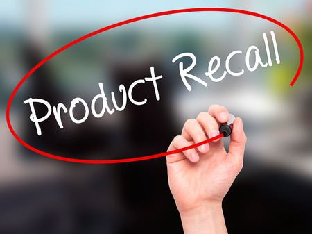 recall: Man Hand writing Product Recall with black marker on visual screen. Isolated on office. Business, technology, internet concept. Stock Photo