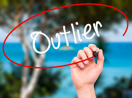 outsider: Man Hand writing Outlier  with black marker on visual screen. Isolated on background. Business, technology, internet concept. Stock Photo Stock Photo