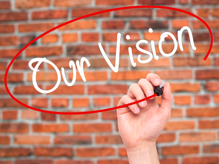 our vision: Man Hand writing Our Vision with black marker on visual screen. Isolated on bricks. Business, technology, internet concept. Stock Photo Stock Photo