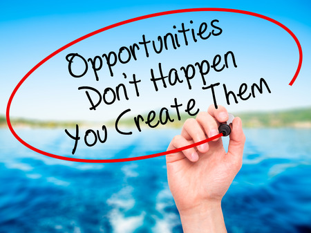 Man Hand writing Opportunities Don't Happen You Create Them with black marker on visual screen. Isolated on background. Business, technology, internet concept. Stock Photo Standard-Bild