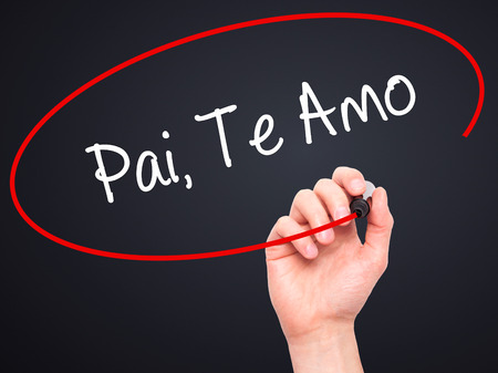 te: Man Hand writing Pai, Te Amo (In portuguese - Love You, Dad) with black marker on visual screen. Isolated on black. Business, technology, internet concept.
