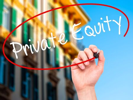 equity: Man Hand writing Private Equity with black marker on visual screen. Isolated on city. Business, technology, internet concept. Stock Photo