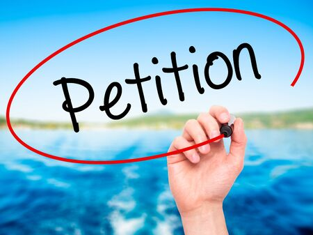 petition: Man Hand writing Petition with black marker on visual screen. Isolated on background. Business, technology, internet concept. Stock Photo Stock Photo