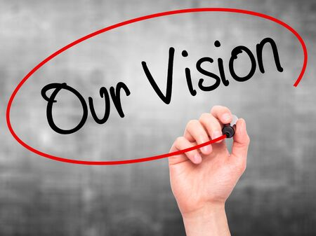 fulfill: Man Hand writing Our Vision with black marker on visual screen. Isolated on grey. Business, technology, internet concept. Stock Photo Stock Photo