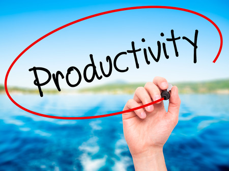 yielding: Man Hand writing  Productivity with black marker on visual screen. Isolated on nature. Business, technology, internet concept. Stock Photo