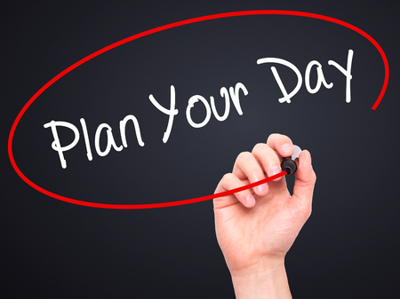 strategic focus: Man Hand writing Plan Your Day with black marker on visual screen. Isolated on background. Business, technology, internet concept. Stock Photo Stock Photo