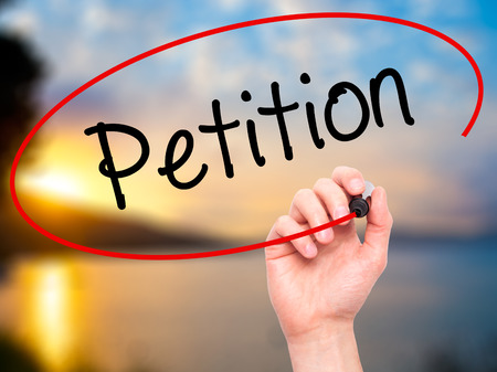 court process: Man Hand writing Petition with black marker on visual screen. Isolated on background. Business, technology, internet concept. Stock Photo Stock Photo