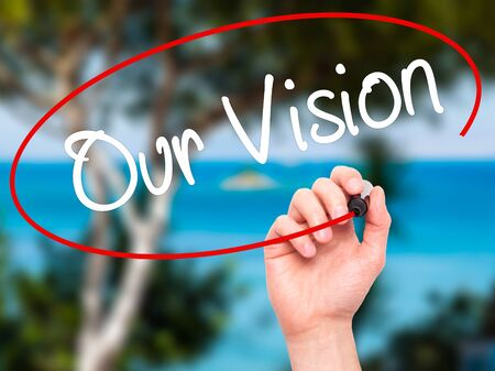 fulfill: Man Hand writing Our Vision with black marker on visual screen. Isolated on nature. Business, technology, internet concept. Stock Photo