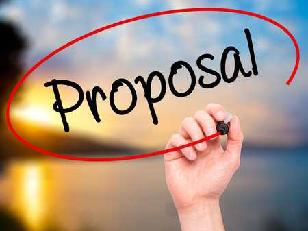 Man Hand writing  Proposal with black marker on visual screen. Isolated on background. Business, technology, internet concept. Stock Photo