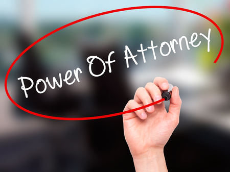 deeds: Man Hand writing Power Of Attorney with black marker on visual screen. Isolated on office. Business, technology, internet concept. Stock Photo