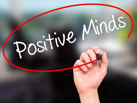 open minded: Man Hand writing Positive Minds with black marker on visual screen. Isolated on office. Business, technology, internet concept. Stock Photo Stock Photo
