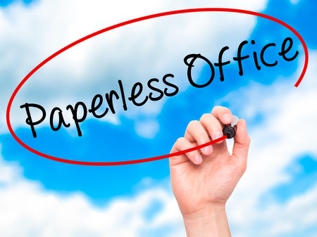 paperless: Man Hand writing Paperless Office  with black marker on visual screen. Isolated on sky. Business, technology, internet concept. Stock Photo