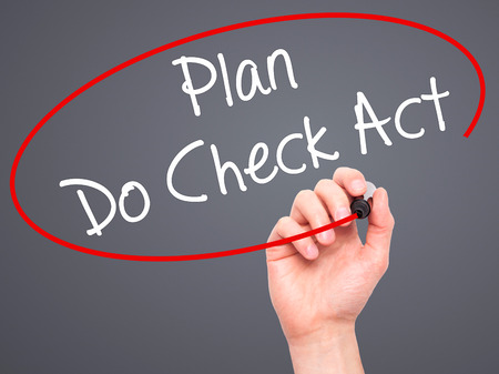 plan do check act: Man Hand writing Plan Do Check Act  with black marker on visual screen. Isolated on grey. Business, technology, internet concept. Stock Photo