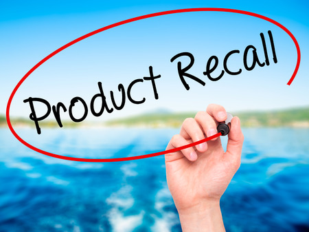 recall: Man Hand writing Product Recall with black marker on visual screen. Isolated on nature. Business, technology, internet concept. Stock Photo