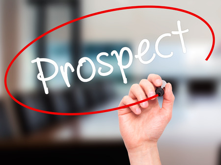 qualify: Man Hand writing Prospect with black marker on visual screen. Isolated on office. Business, technology, internet concept. Stock Image