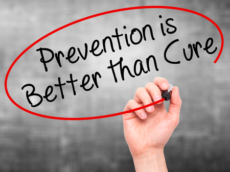 cure prevention: Man Hand writing Prevention is Better than Cure with black marker on visual screen. Isolated on grey. Business, technology, internet concept. Stock Image