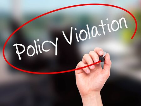violation: Man Hand writing Policy Violation with black marker on visual screen. Isolated on office. Business, technology, internet concept. Stock Photo Stock Photo