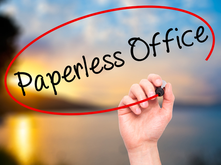 paperless: Man Hand writing Paperless Office  with black marker on visual screen. Isolated on nature. Business, technology, internet concept. Stock Photo Stock Photo