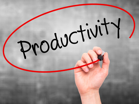 yielding: Man Hand writing  Productivity with black marker on visual screen. Isolated on grey. Business, technology, internet concept. Stock Photo