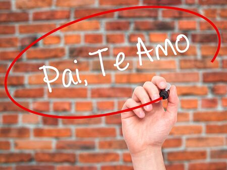te: Man Hand writing Pai, Te Amo (In portuguese - Love You, Dad) with black marker on visual screen. Isolated on bricks. Business, technology, internet concept.