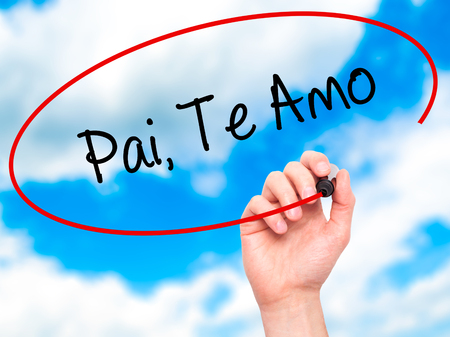 paternal: Man Hand writing Pai, Te Amo (In portuguese - Love You, Dad) with black marker on visual screen. Isolated on sky. Business, technology, internet concept. Stock Photo