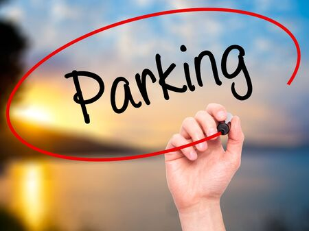 visual screen: Man Hand writing Parking with black marker on visual screen. Isolated on nature. Business, technology, internet concept. Stock Photo