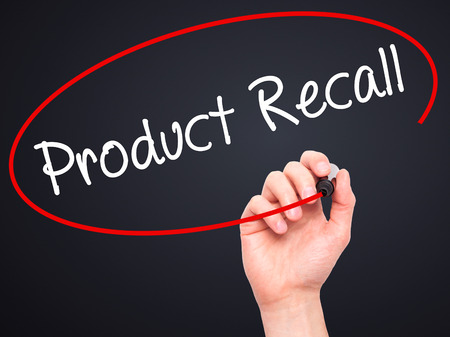 recall: Man Hand writing Product Recall with black marker on visual screen. Isolated on black. Business, technology, internet concept. Stock Photo