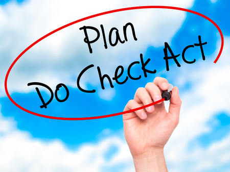 plan do check act: Man Hand writing Plan Do Check Act  with black marker on visual screen. Isolated on sky. Business, technology, internet concept. Stock Photo Stock Photo