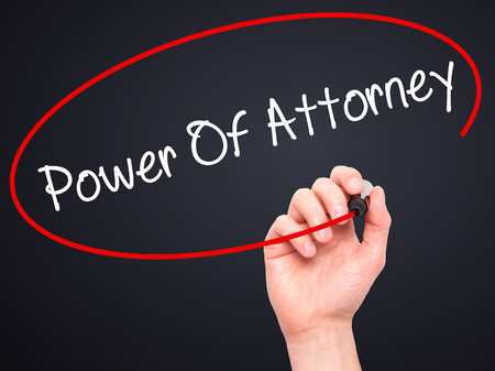 successor: Man Hand writing Power Of Attorney with black marker on visual screen. Isolated on black. Business, technology, internet concept. Stock Photo